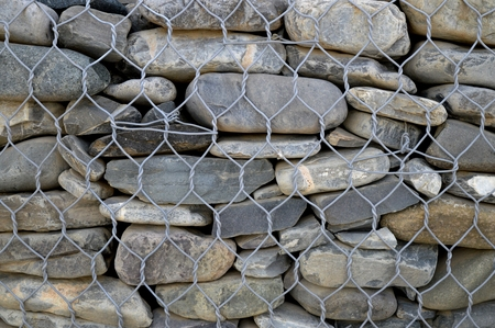 caspian: A wall that is constructed of river stones. Stock Photo