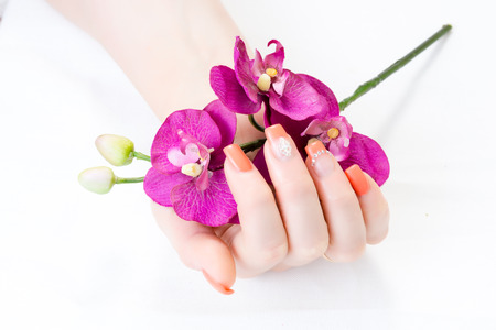 manicure with decor, orchid,isolated on white background. spa