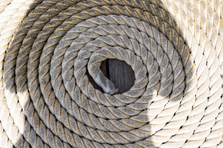 Rope on a sailing boat laying on the wooden plank ground Stock Photo