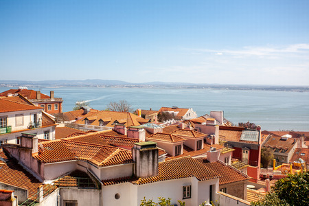 Old Lisbon Portugal street. cityscape with roofs. Tagus river miraduro viewpoint. Spring and summer.