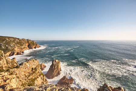 Exploring Portugal. Cabo da Roca ocean and mountains view, authentic capture, wanderlust concept. summer spring