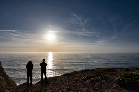 Exploring Portugal. Cabo da Roca ocean and mountains view, authentic capture, wanderlust concept. summer spring sunset silhouettes