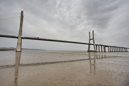 The Vasco da Gama Bridge in Lisbon, Portugal in a summer day. spring Standard-Bild