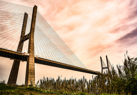 The Vasco da Gama Bridge in Lisbon, Portugal in a summer day. spring Banco de Imagens