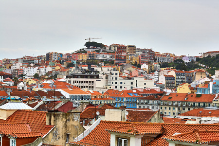 Old Lisbon Portugal steet. cityscape with roofs. Tagus river miraduro viewpoint. Spring and summer