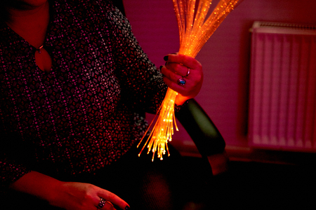 woman in color therapy in the retirement care home. multi sensory stimulating healthcare room space