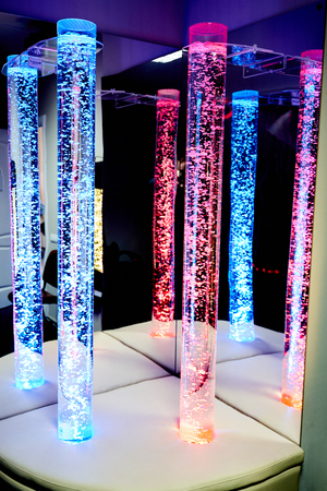 therapy sensory stimulating multi sensory room with colored lights bubble tube lamp during therapy healthcare retirement home session