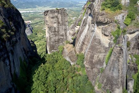 Legendary aerial drone view of ancient monasteries and breathtaking picturesque valley and landmark canyon of Meteora, Greece in summer Banco de Imagens