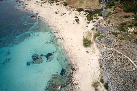 Aerial shot of beautiful turquoise beach Falasarna (Falassarna) in Crete, Greece. View of famous paradise sandy deep turquoise beach of Falasarna (Falassarna) in North West, Crete island, Greece in summer