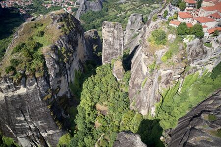 Legendary aerial drone view of ancient monasteries and breathtaking picturesque valley and landmark canyon of Meteora, Greece in summer Editorial