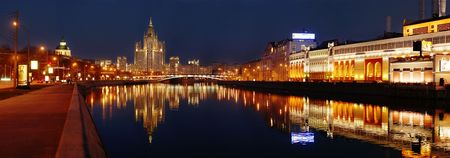 panoramic photo of a night city on a bank of a river Banque d'images