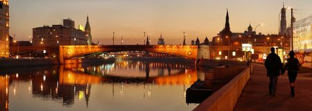 panoramic photo of a night city on a bank of a river Stockfoto