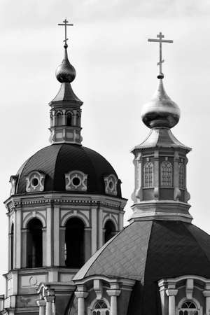 unsaturated: a photo of an Orthodox Church with green walls and golden domes stand behind the trees