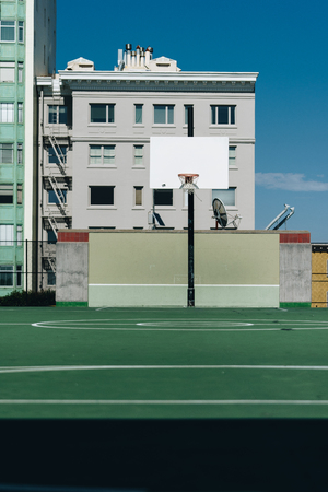 in basketball, the basketball court is the playing surface, consisting of a rectangular floor with baskets at either end.