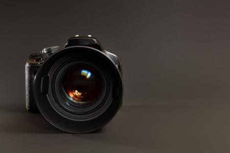 Photo camera in dark background Stock Photo