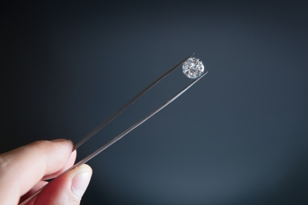 tweezers: White diamond holding hand Stock Photo