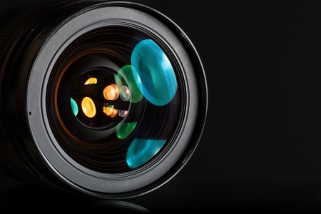 Professional photo lens in dark background photo
