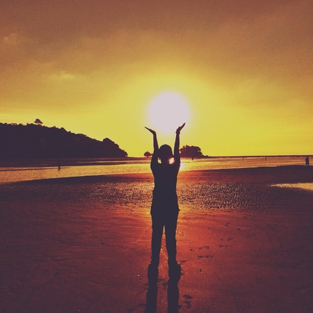 style: Silhouette of human hold the sun in vintage style