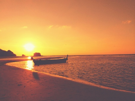 style: Floating boat in vintage style with sunset time
