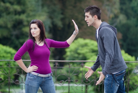 Couple fighting. A young man is trying to apologize, while his girlfriend doesn't want to hear it  Stock Photo - 9687960