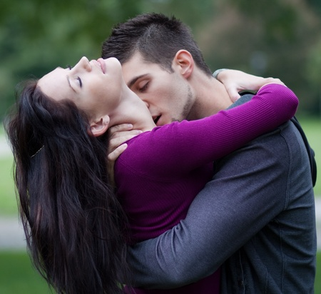 Young man passionately kissing his girlfriend on her neck  Stock Photo - 9687749