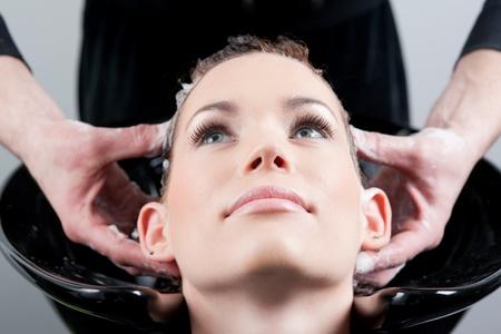 Close up shot of hairwashhair massage at the hairdresser  photo