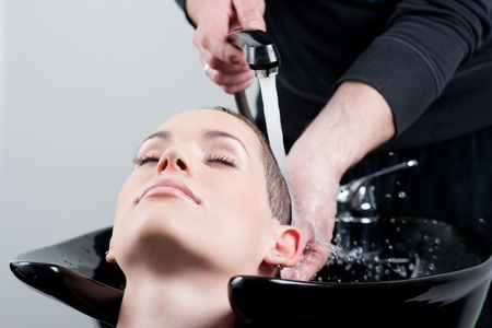 Close up shot of hairwash at the hairdresser Stock Photo - 9687725