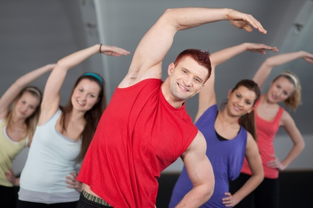 A group of young people stretching at a health club  photo