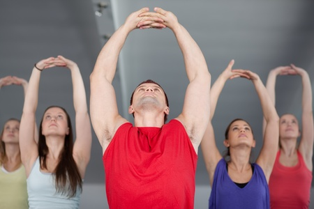A group of young people stretching in aerobics class  photo