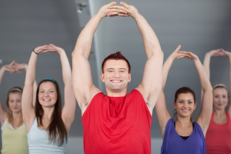 A group of young people stretching in a health club  photo