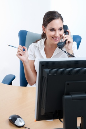 Happy young businesswoman talking on the phone  Stock Photo - 9688722