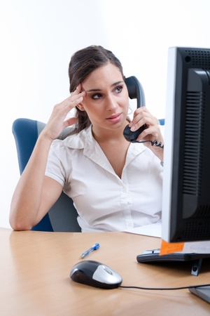 Worried young businesswoman receiveing bad news over the phone Stock Photo - 9688721