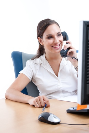 Young businesswoman talking on the phone in her office Stock Photo - 9688702