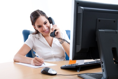 Young business woman taking notes over the phone  Stock Photo - 9689313