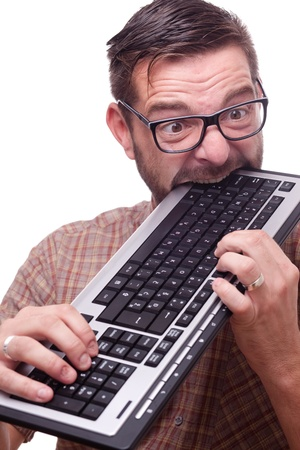 Geek is hysterically biting the keyboard Stock Photo - 9689030