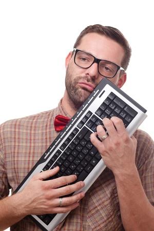 nerd glasses: Geek loving his keyboard