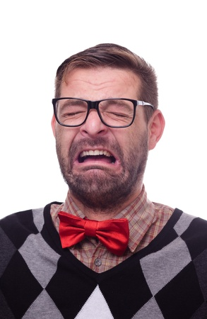 Portrait of a crying nerd. Isolated on white. Stock Photo - 9689047