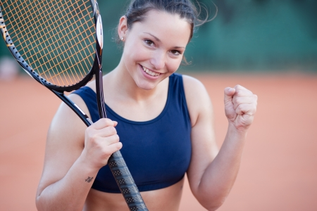 Cheerful tennis player, celebrating after the match Stock Photo - 9689296