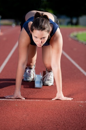 focused: Female athlete ready to go