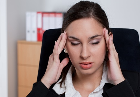 Stressed businesswoman in her office Stock Photo - 9689243