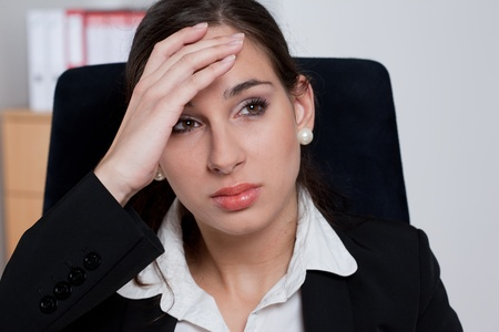 Tired businesswoman with headache/stress related problems Stock Photo - 9689016