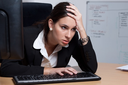 fed: Exhausted businesswoman, fed up with all the work she has to do Stock Photo