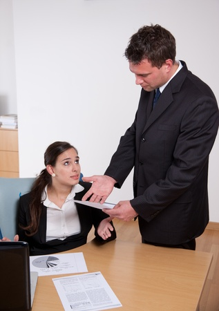 work force: Boss showing dissatisfation with his secretarys work  Stock Photo