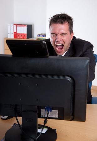 banging: Office rage series. Businessman losing it.  Stock Photo