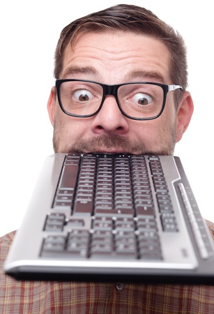Nerd biting into a keyboard Stock Photo - 9779368