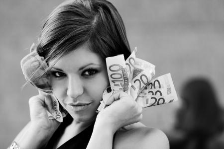 corporate greed: Beautiful girl with Euro bills