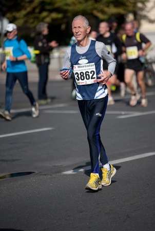 Senior man running the Ljubljana marathon photo