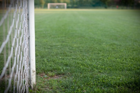 grassy: Football field. Close up view of the goal post. Pitch in the background. Stock Photo