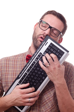 Nerd in love with his keyboard Stock Photo - 9878756
