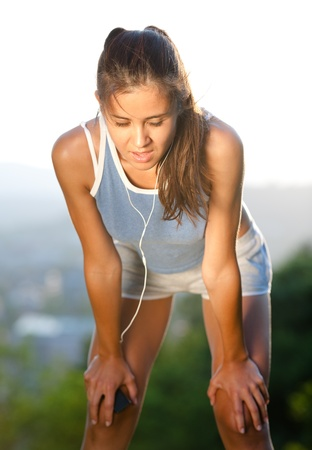 Beautiful fit young woman exhaused after training photo